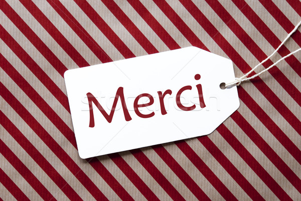 Label On Red Wrapping Paper, Merci Means Thank You Stock photo © Nelosa
