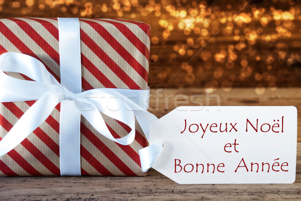 Atmospheric Christmas Gift With Label, Bonne Annee Means New Yea Stock photo © Nelosa