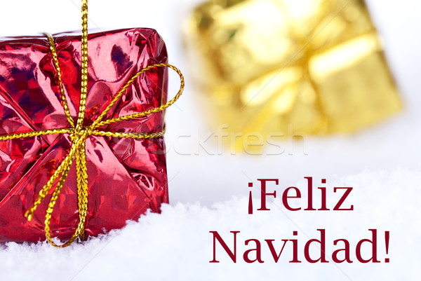 Feliz Navidad in the Snow with Gifts Stock photo © Nelosa