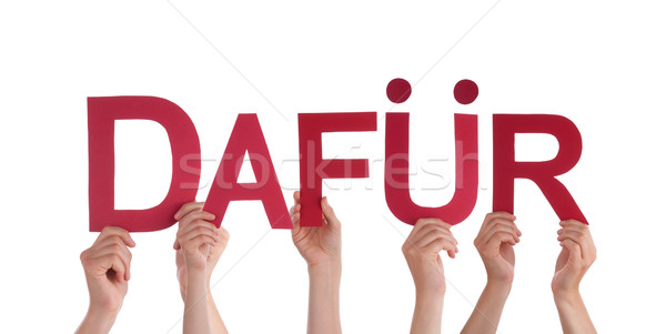 People Holding Red Straight German Word Dafuer Means For It Stock photo © Nelosa