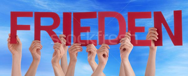 People Holding Straight German Word Frieden Means Peace Blue Sky Stock photo © Nelosa