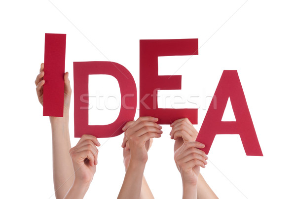 Many People Hands Holding Red Word Idea Stock photo © Nelosa