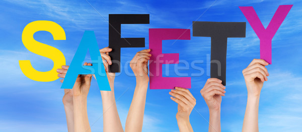 People Hands Holding Colorful Word Safety Blue Sky Stock photo © Nelosa