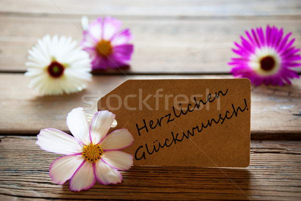 Label With German Text Herzlichen Glueckwunsch Means Best Wishes With Cosmea Blossoms Stock photo © Nelosa