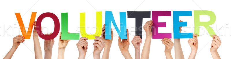 People Hand Hold Colorful Straight Word Volunteer  Stock photo © Nelosa