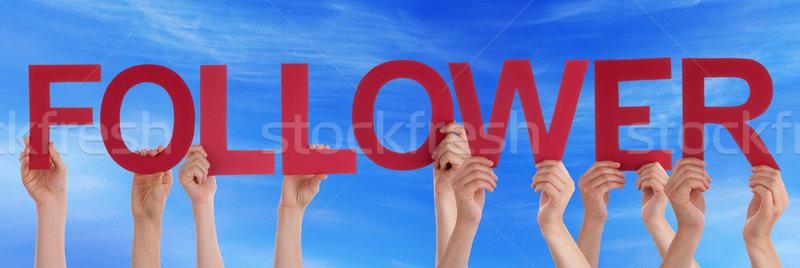 Hands Holding Red Straight Word Follower Blue Sky Stock photo © Nelosa