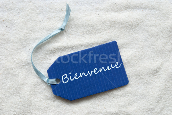 Bienvenue Means Welcome On Blue Label Sand Background Stock photo © Nelosa