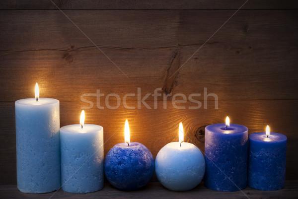Christmas dekoracji niebieski świece świetle ciemne Zdjęcia stock © Nelosa