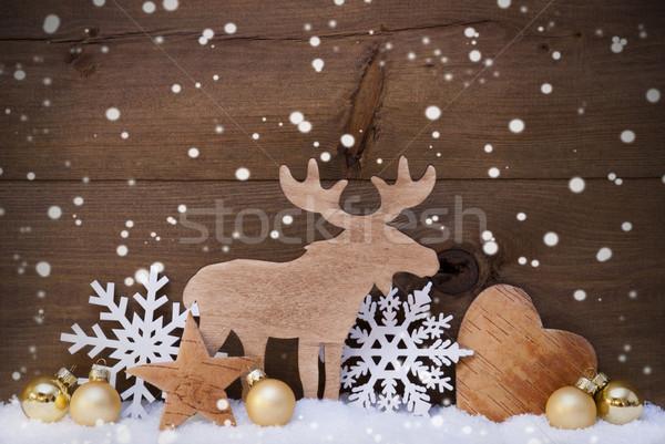 Arany karácsony dekoráció hó jávorszarvas hall Stock fotó © Nelosa