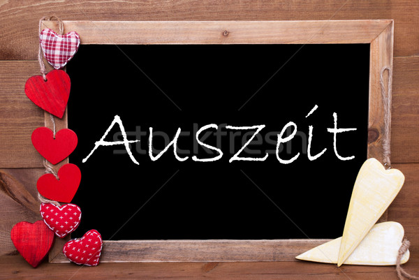 One Chalkbord, Red And Yellow Hearts, Auszeit Means Downtime Stock photo © Nelosa