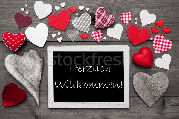 Chalkbord With Many Red Hearts, Willkommen Means Welcome Stock photo © Nelosa