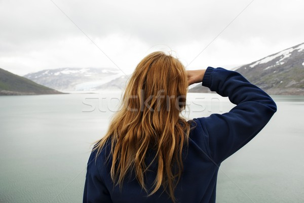 Nő néz gleccser szabadtér néz víz Stock fotó © Nelosa