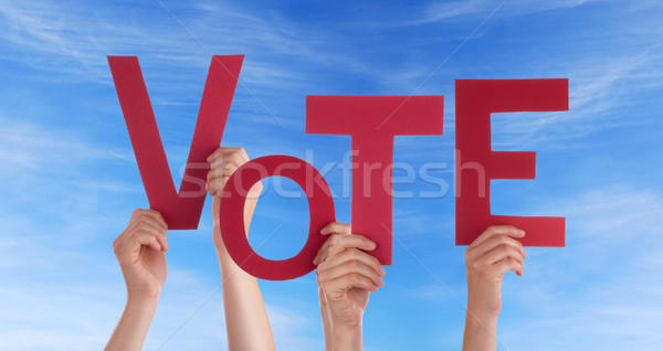 Hands Holding Vote in the Sky Stock photo © Nelosa