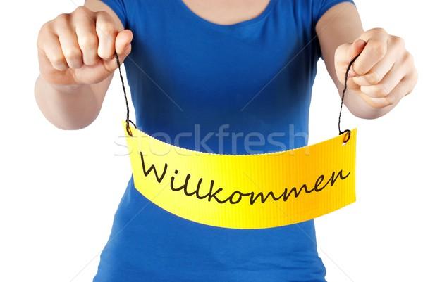 hands holding tag WIllkommen Stock photo © Nelosa