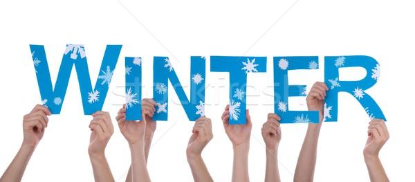 Hands Holding Blue Winter Stock photo © Nelosa