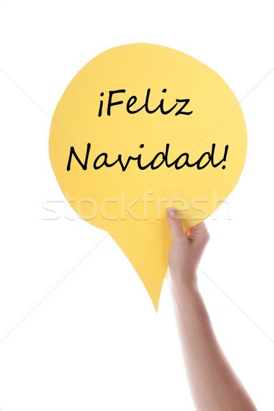 Citromsárga szöveglufi kéz tart szövegbuborék spanyol Stock fotó © Nelosa