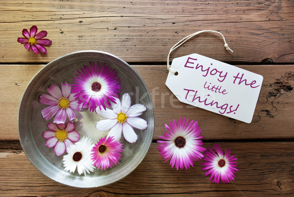 Silver Bowl With Cosmea Blossoms With Life Quote Enjoy The Little Things Stock photo © Nelosa