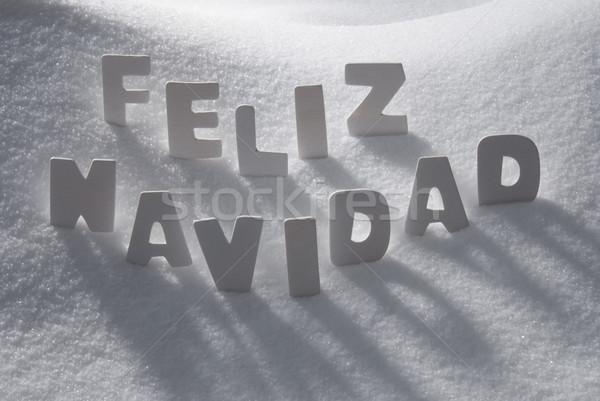 White Word Feliz Navidad Means Merry Christmas On Snow Stock photo © Nelosa