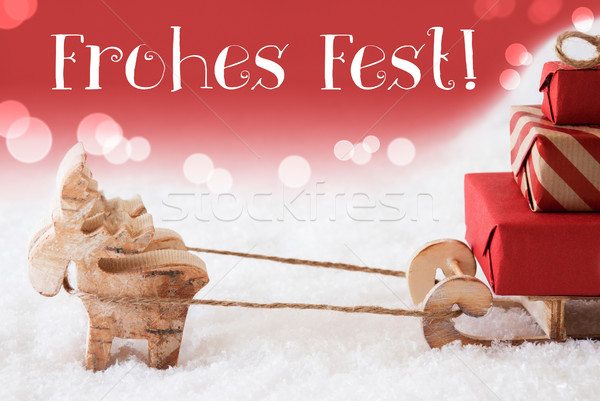 Reindeer With Sled, Red Background, Frohes Fest Means Merry Christmas Stock photo © Nelosa