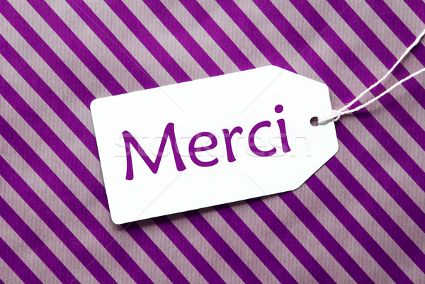 Label On Purple Wrapping Paper, Merci Means Thank You Stock photo © Nelosa