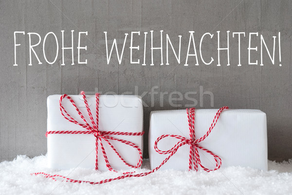 Two Gifts With Snow, Frohe Weihnachten Means Merry Christmas Stock photo © Nelosa