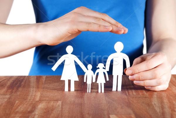 hand protecting a family Stock photo © Nelosa