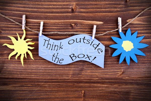 Light Blue Lable Saying Think Outside The Box Stock photo © Nelosa