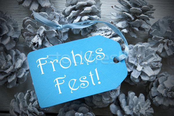Light Blue Label On Fir Cones Frohes Fest Means Merry Christmas Stock photo © Nelosa