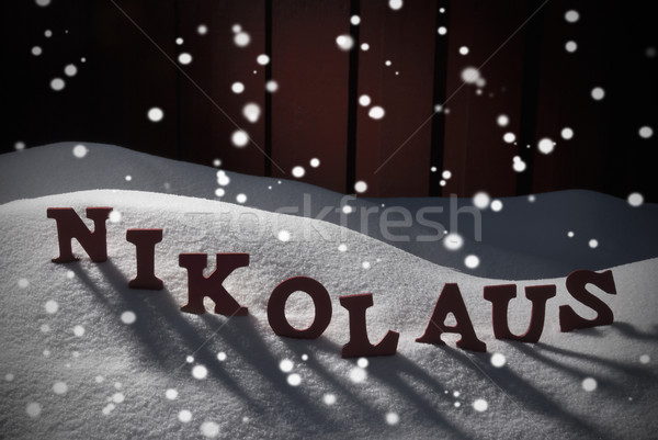 Nikolaus Mean Santa Claus On Snow And Snowflakes Stock photo © Nelosa