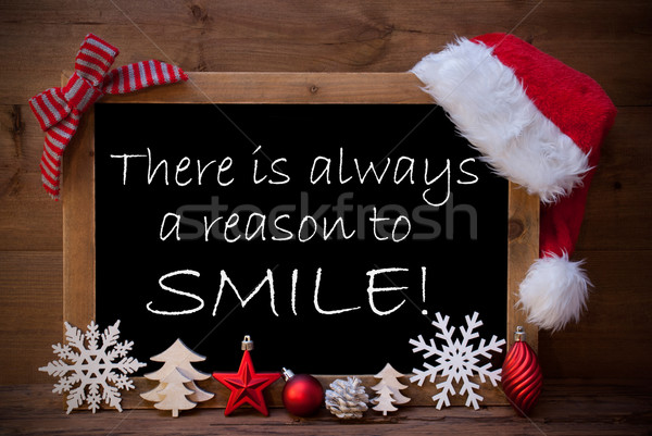 Brown Blackboard Santa Hat Christmas Decor Quote Reason Smile Stock photo © Nelosa