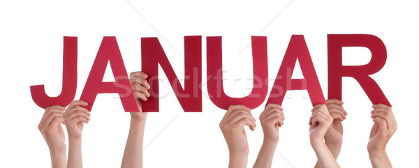 People Holding Straight German Word Januar Means January Stock photo © Nelosa