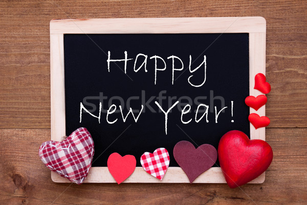 Blackboard With Textile Hearts, Text Happy New Year Stock photo © Nelosa