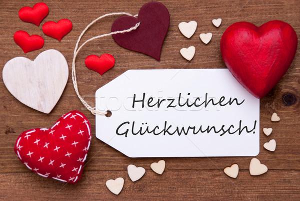 Etiqueta rojo corazones felicitaciones textiles Foto stock © Nelosa