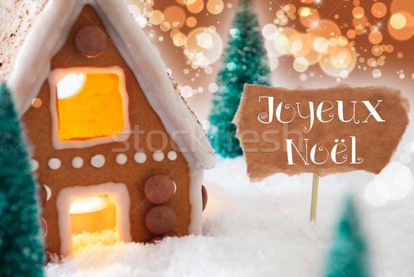 Gingerbread House, Bronze Background, Joyeux Noel Means Merry Christmas Stock photo © Nelosa