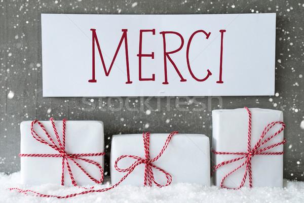 White Gift With Snowflakes, Merci Means Thank You Stock photo © Nelosa