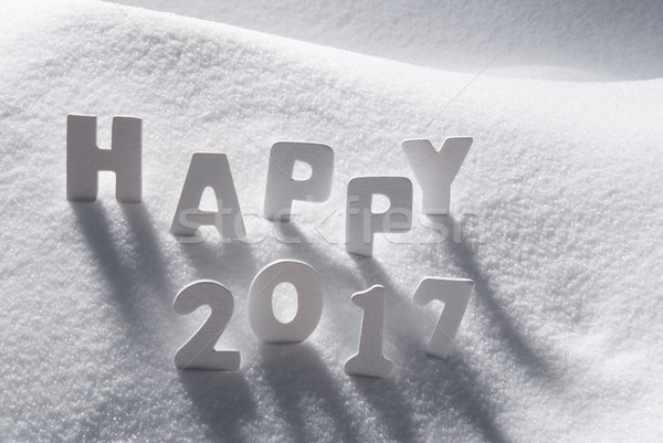 Text Happy 2017 With White Letters In Snow Stock photo © Nelosa