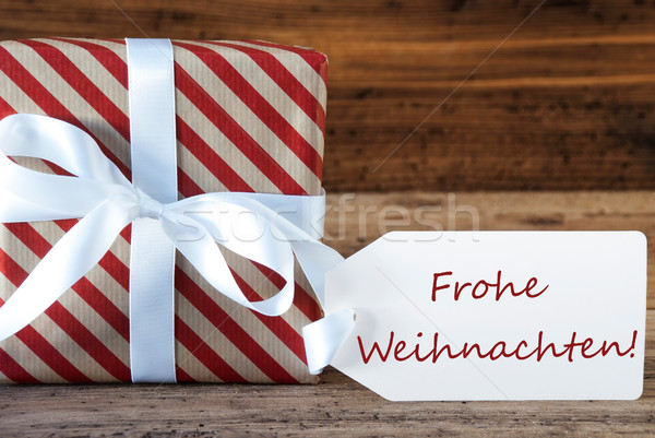 Present With Label, Frohe Weihnachten Means Merry Christmas Stock photo © Nelosa