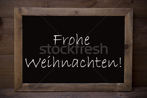 Chalkboard With Frohe Weihnachten Means Merry Christmas Stock photo © Nelosa