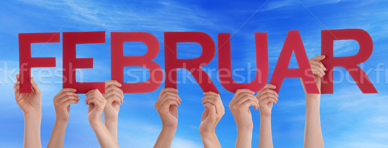 People Holding Straight German Word Februar Means February Blue Stock photo © Nelosa