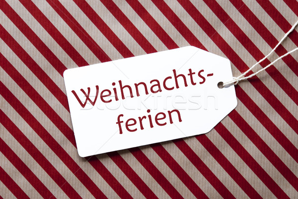 Label On Red Wrapping Paper, Weihnachtsferien Means Christmas Break Stock photo © Nelosa