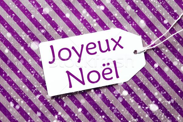 Label On Purple Paper, Snowflakes, Joyeux Noel Means Merry Christmas Stock photo © Nelosa