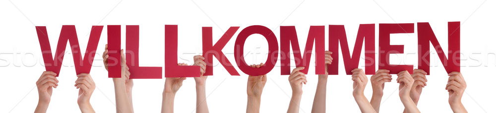 People Holding Straight German Word Willkommen Means Welcome Stock photo © Nelosa