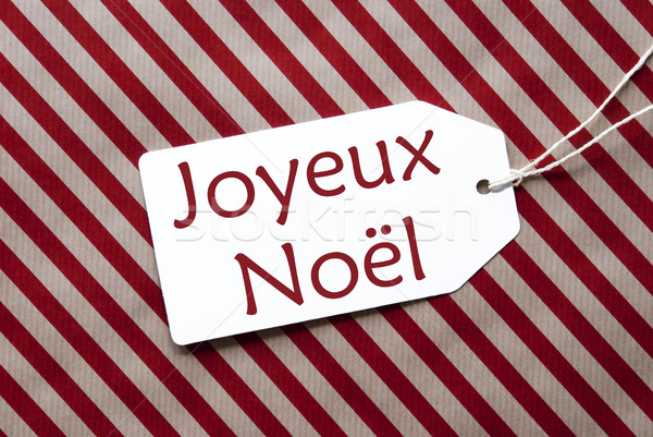 Label On Red Wrapping Paper, Joyeux Noel Means Merry Christmas Stock photo © Nelosa