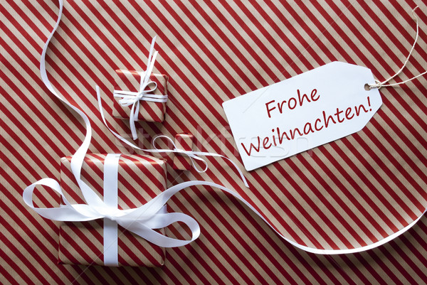 Two Gifts With Label, Frohe Weihnachten Means Merry Christmas Stock photo © Nelosa
