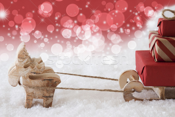 Reindeer With Sled, Red Bokeh And Stars Background, Copy Space Stock photo © Nelosa