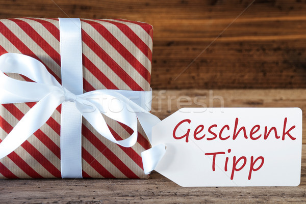 Present With Label, Geschenk Tipp Means Gift Tip Stock photo © Nelosa