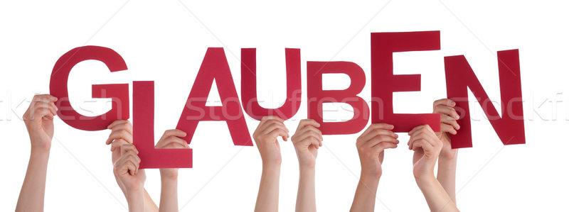 People Holding German Word Glauben Means Believe Stock photo © Nelosa