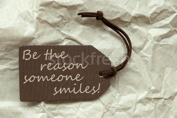 Brown Label With Quote Reason Someone Smiles Paper Background Stock photo © Nelosa