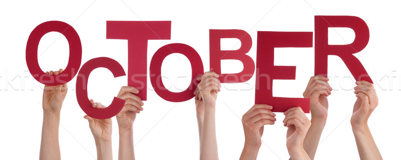 Many People Hands Holding Red Word October Stock photo © Nelosa