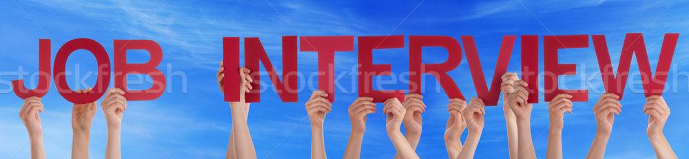 Mão manter vermelho em linha reta palavra entrevista de emprego Foto stock © Nelosa
